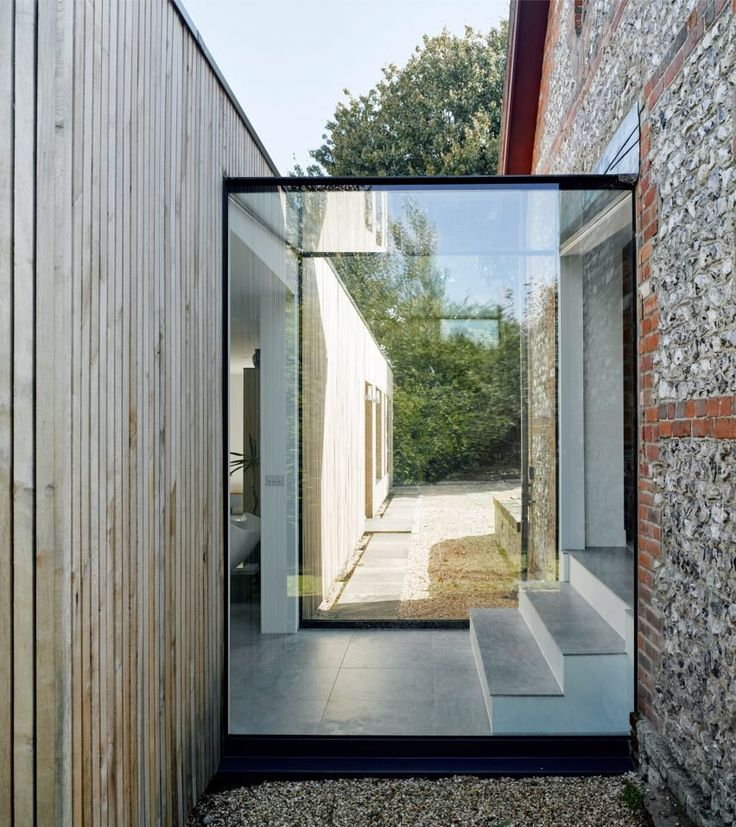 Adam Knibb Architects extends Hampshire barn conversion with timber-clad box…