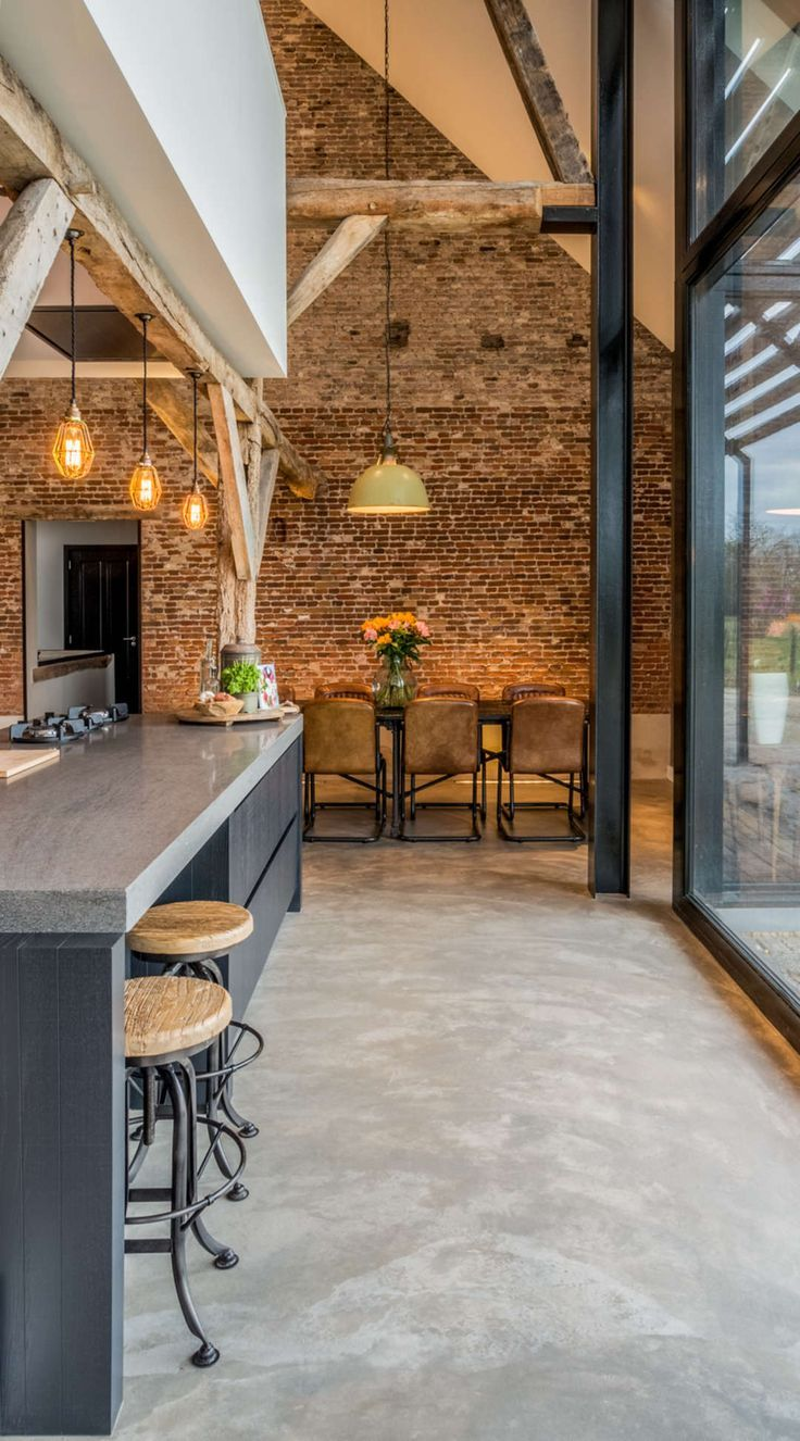 Converting an old farm into a warm industrial farmhouse with big view on an old …