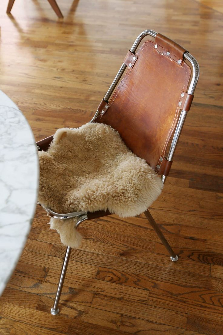Charlotte Perriand Dining Chairs – Leather sling with swatches of fur…